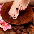 Beautiful women legs with black pedicure after Spa procedures — Stock Photo