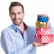Stock Photo: Portrait of happy young man with gifts.