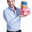 Portrait of happy young man with gifts. — Stock Photo