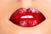 Macro photo of a red woman's lips  — Stock Photo