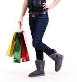 Woman in autumn boots with shopping bags. — Stock Photo