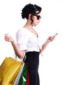 Woman with shopping bags and mobile phone. — Stockfoto