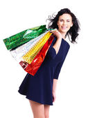 Beautiful happy woman with shopping bags. — Stockfoto