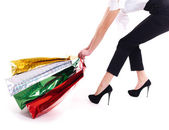 Attractive woman drags shopping bags. — Stock Photo