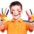 Happy smiling boy with a painted hands and face. — Stock Photo #42023549