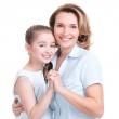 Closeup portrait of happy mother and young daughter — Stock Photo #42023577