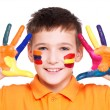 Happy smiling boy with a painted hands and face. — Stock Photo #42023789