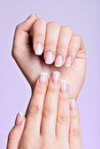 Beautiful woman's hands with beautiful  nails — Stock Photo