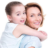 Closeup portrait of happy mother and young daughter — Stock Photo
