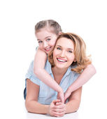 Portrait of smiling mother and young daughter — Stock Photo