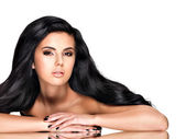 Beautiful brunette woman with long black  hair — Stock Photo