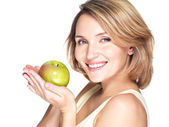 Young happy smiling woman with green apple. — Stock Photo