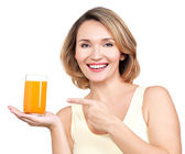 Portrait of a beautiful young woman with a glass of juice. — Stock Photo