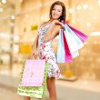 Stockfoto: Woman with shopping bags at shop