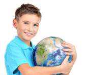 Smiling boy in casual  holding planet earth — Stock Photo