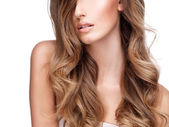 Wavy hair of a pretty young woman — Stock Photo