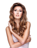 Sexy woman with beautiful long wavy hair — Stock Photo