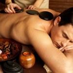 Man having stone massage in spa salon — Stock Photo #42448727