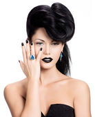 Glamour woman's nails , lips and eyes painted color black. — Stock Photo