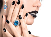 Closeup face of young beautiful woman with black manicure — Stock Photo