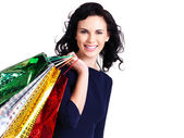 Beautiful happy woman with shopping bags. — Stock Photo