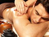 Man having massage in the spa salon — Stock Photo