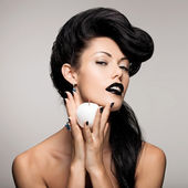 Fashion woman with modern hairstyle  with white apple — Stock Photo