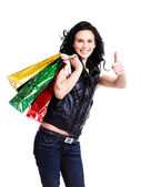 Happy smiling woman with shopping bags. — Stock Photo