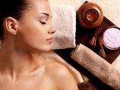 Calm woman relaxing in spa salon — Stock Photo
