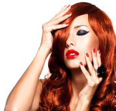Sensual woman with long red hairs and red nails — Stockfoto