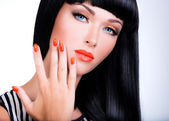 Portrait of a woman with red nails and glamour makeup  — Stock Photo
