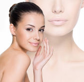 Beautiful woman cares for the face — Stock Photo