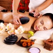 Adult woman having hot stone massage in spa salon — Stock Photo #42859449