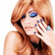 Portrait of a beautiful woman with blue nails, blue makeup — Stock Photo #42859779