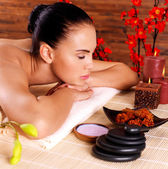 Portrait of an adult beautiful woman relaxing in spa salon — Stock Photo