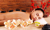 Adult woman relaxing in spa salon — Stock Photo