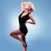 Beautiful sexy woman  in black dress — Stock Photo