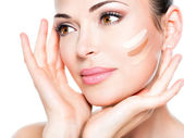 Beautiful face of  woman with cosmetic foundation — Stock Photo
