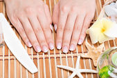 Woman in a nail salon receiving manicure — Stock Photo