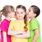 Three little cute smiling girl gossip. — Stock Photo
