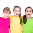 Three cute little cute smiling girls in colorful t-shirts. — Stock Photo #43174997