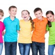Group of happy children in colorful t-shirts. — Stock Photo #43175153