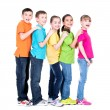 Group of happy children in colorful t-shirts. — Stock Photo