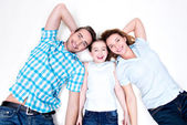 High angle portrait of caucasian happy smiling young family — Stock Photo
