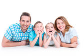 Caucasian happy smiling young family with two children — Stock Photo