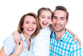 Family with little girl and pretty white smiles  — Stock Photo