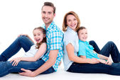 Caucasian happy smiling young family with two children — Стоковое фото