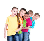 Group of children stand behind each other. — Stock Photo