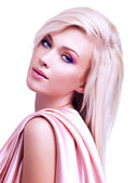 Beautiful tender woman with pink silk. — Stock Photo