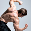 Back view of handsome man with muscular body. — Stock Photo #44551805